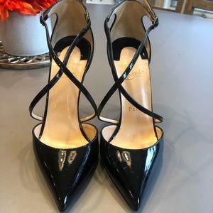 Christian Louboutin black patent leather pumps